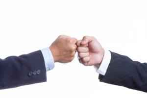 fist bump business men - website
